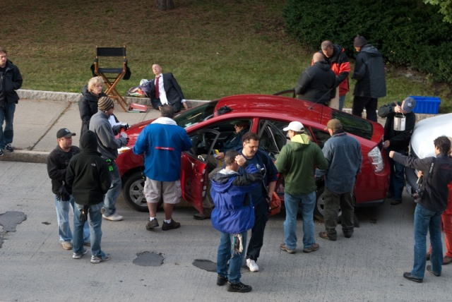 Lots of people gathered around the star Prius, getting it ready for the day's shooting.
